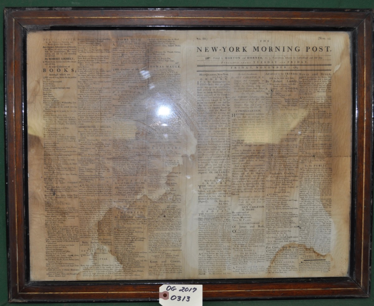 Two Sided Framed Newspaper Article