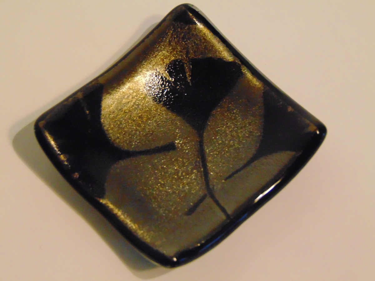 Small dish, Gold irid on black with gingko leaves
