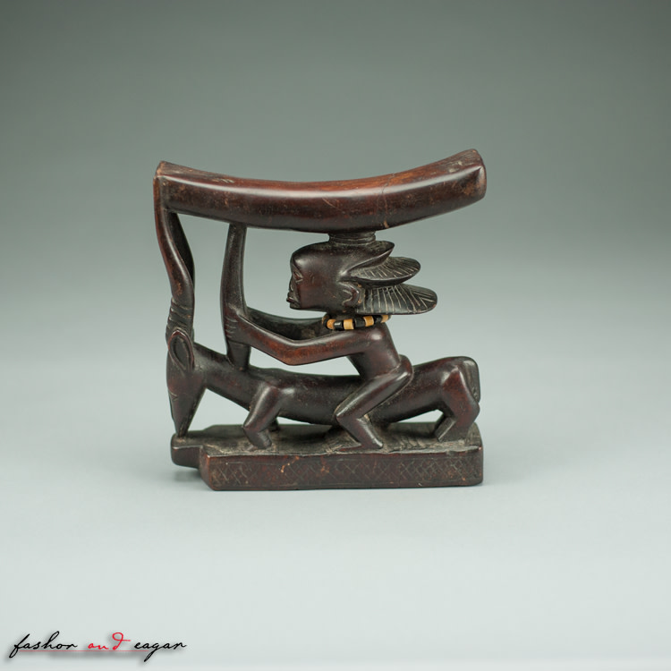 Prestige Headrest: Figure Riding an Antelope