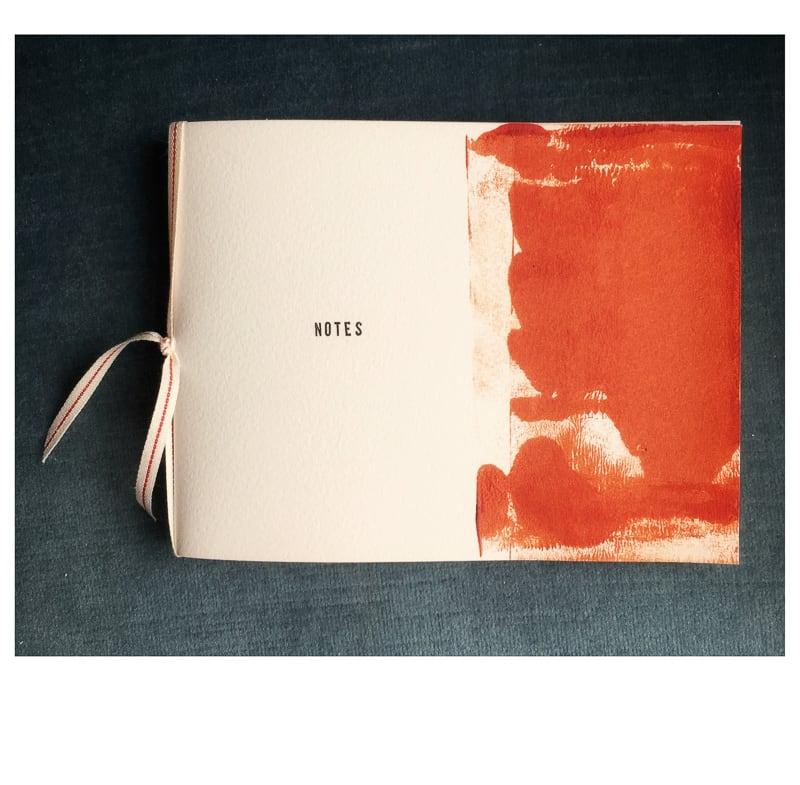 Ribbon bound artist notebook by caroline fraser