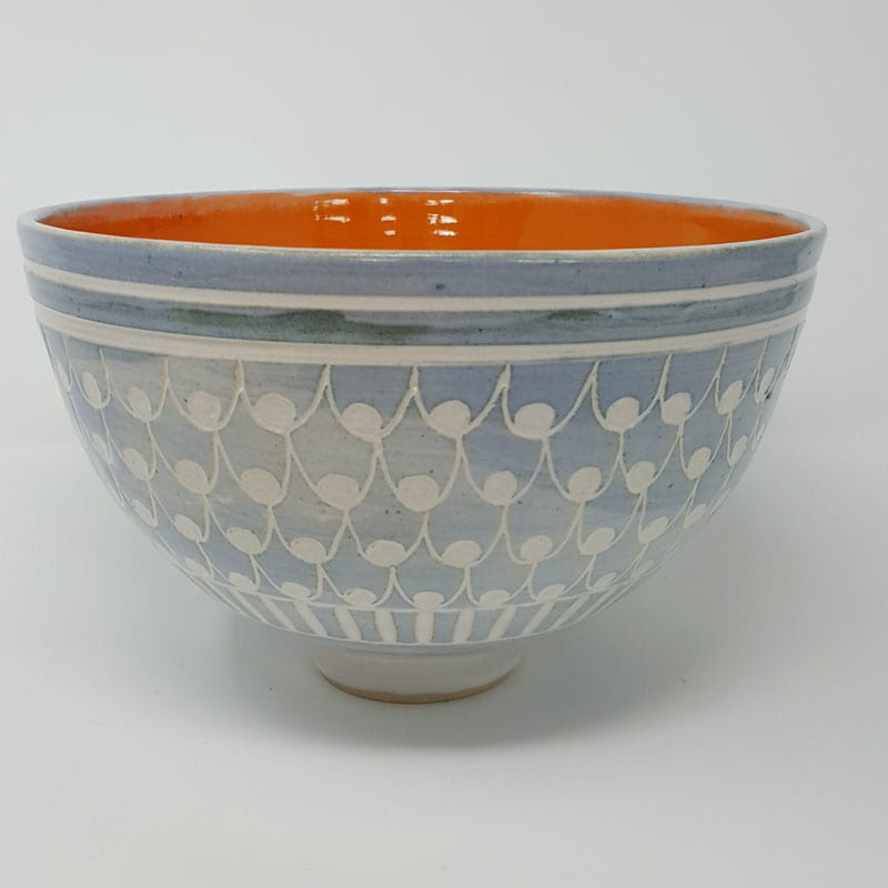 BRI062, Grey Carved Bowl with Orange Interior by Jane Bridger