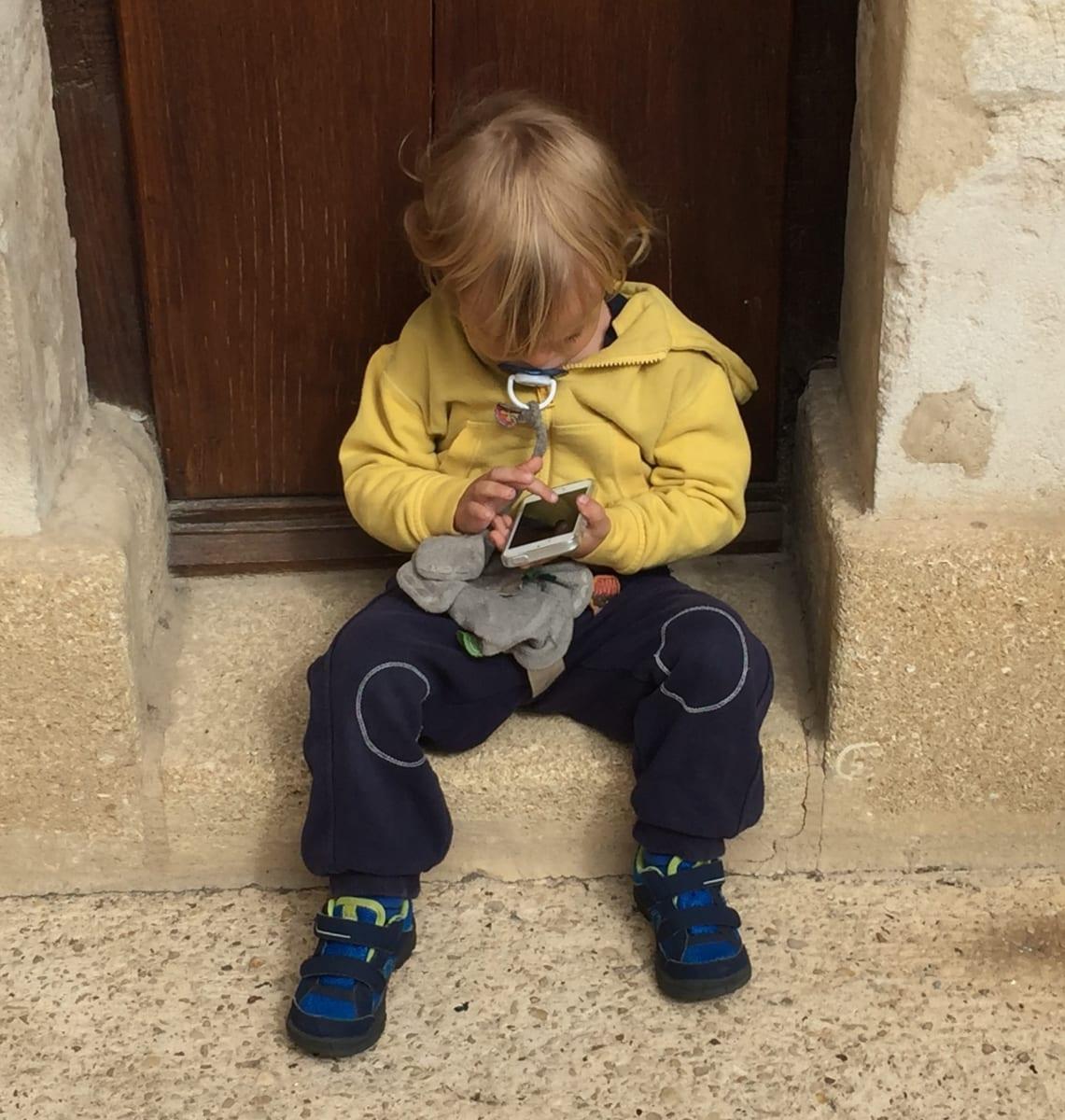Little Boy Texting