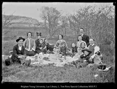 [Family Picnic in Coalville Park] by George Beard  Image: Multiple families picnic in the grass.