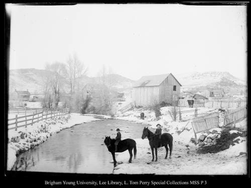 [Coalville Farm Scene in Winter] by George Beard  Image: Two boys on horseback crossing a snow-covered creek.