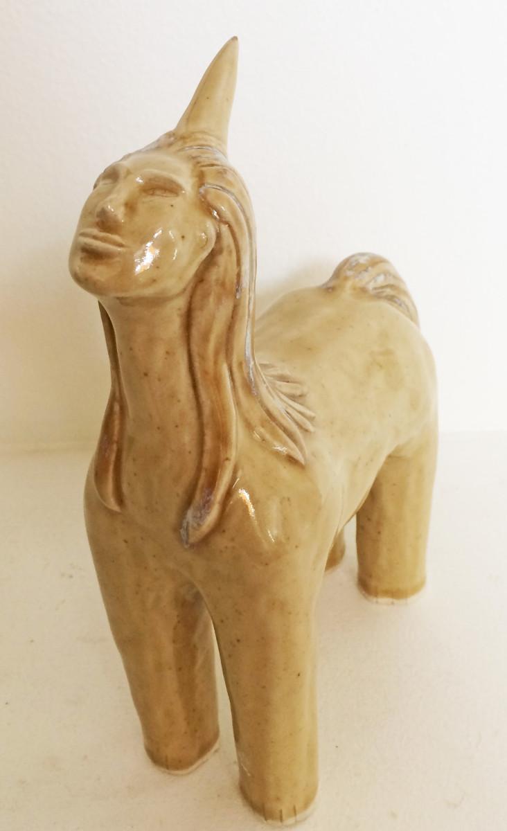 Quinn the Golden unicorn by Nell Eakin