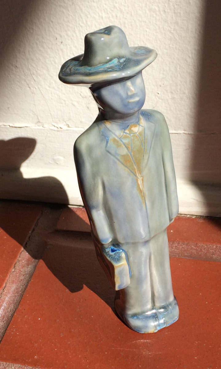 The Man, with turquoise hat by Nell Eakin