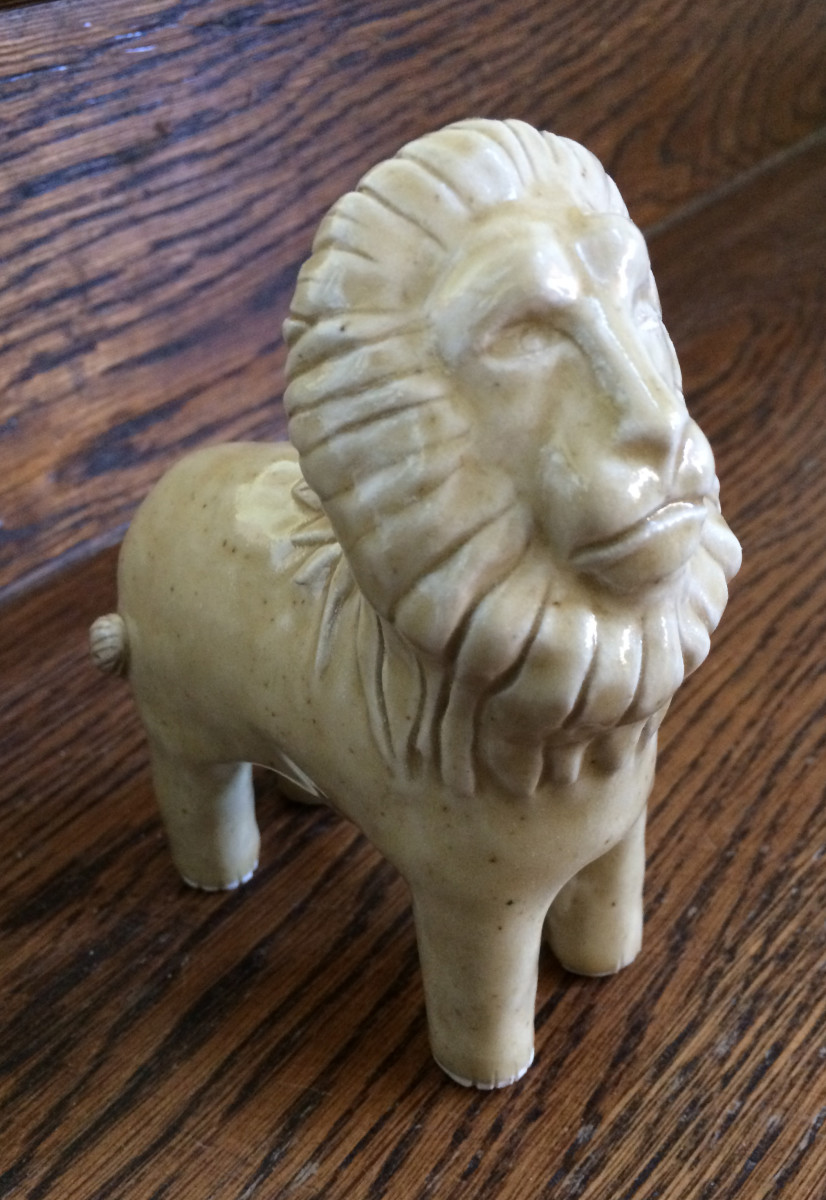 Leonis the inquisitive lion by Nell Eakin