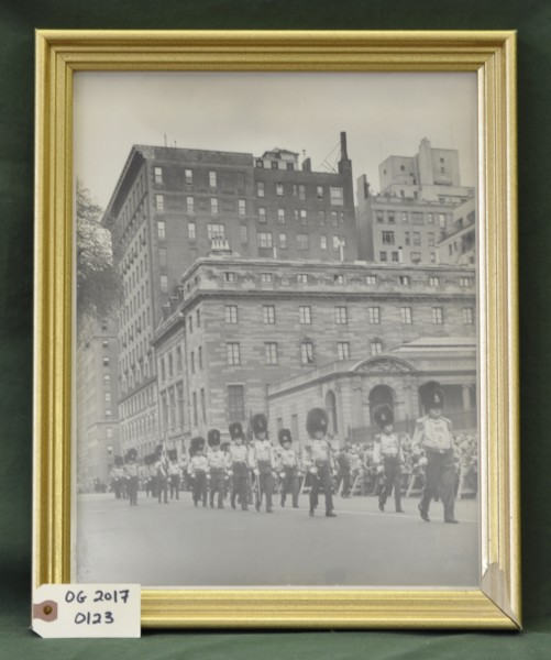 Photograph of the Old Guard Marching on the Street in Front of a Crowd
