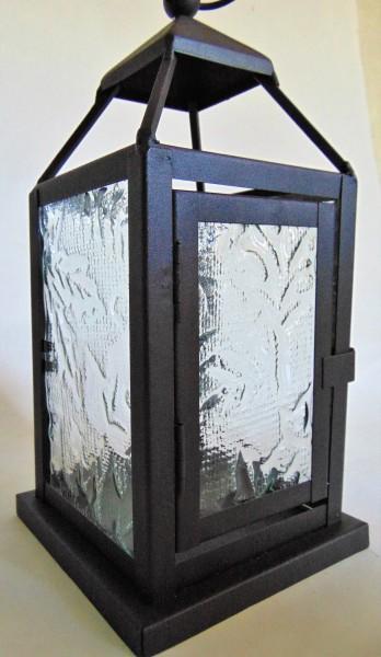 Lantern with impressed leaf panels