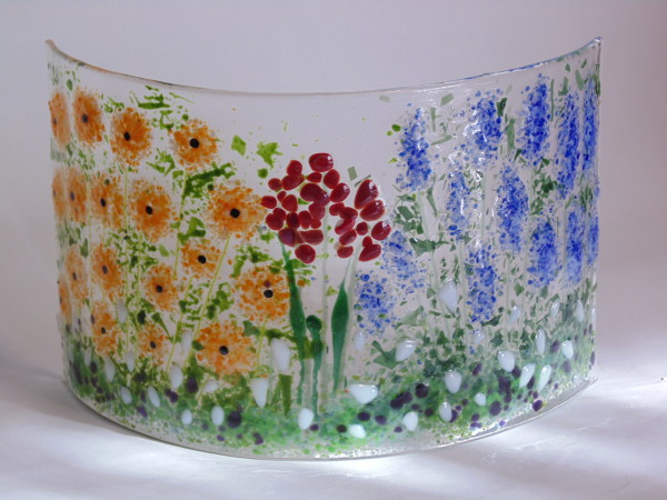 Small garden curve-Delphiniums, poppies, other flowers