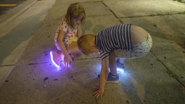 Kids playing on Wildwood sidewalk at Night