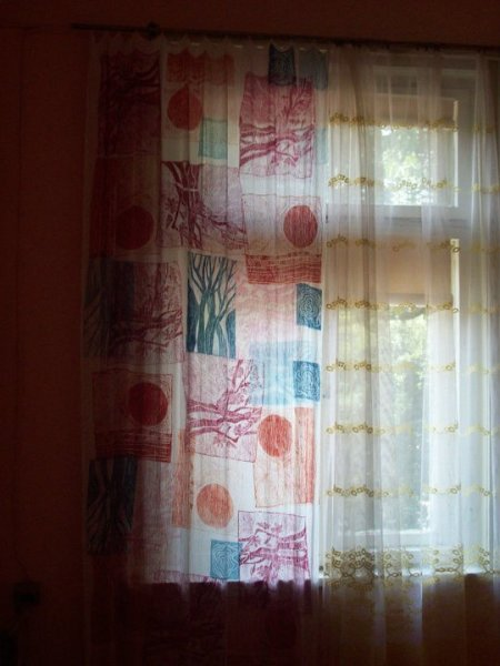 Curtain with linocut stamps