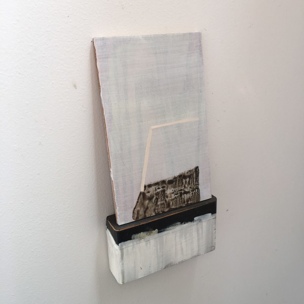 Small, leaning painting on painted  wooden block with tape