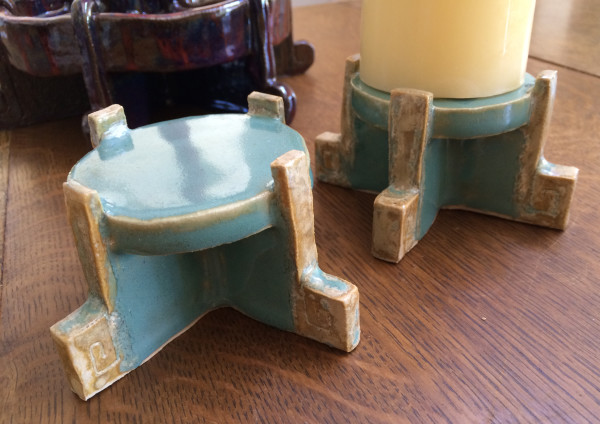Square spiral candle stands, in sky blue and funkified gold.