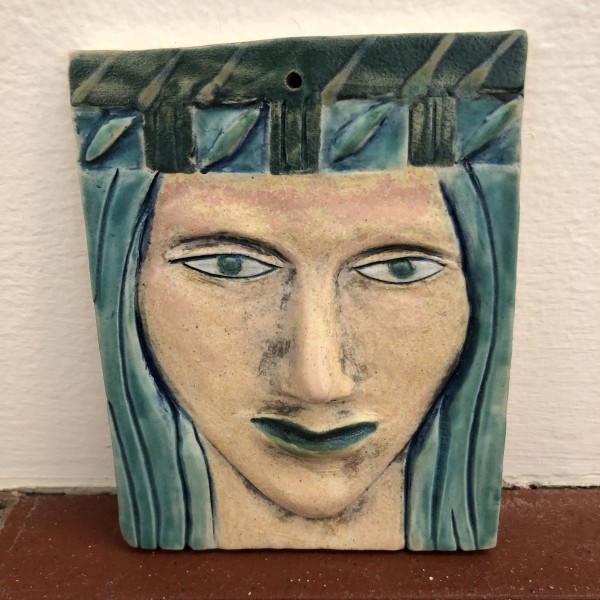 Turquena, a blue haired woman wall hanging woman, with hat