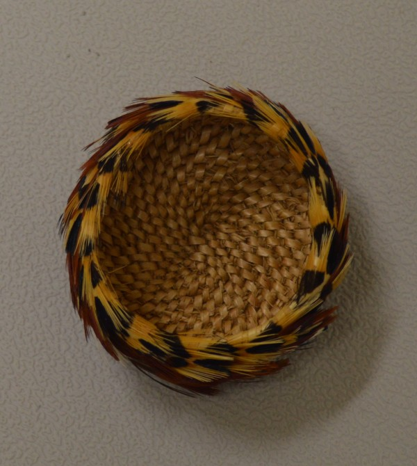Woven willow basket with pheasant feathers by Sandra Eagle