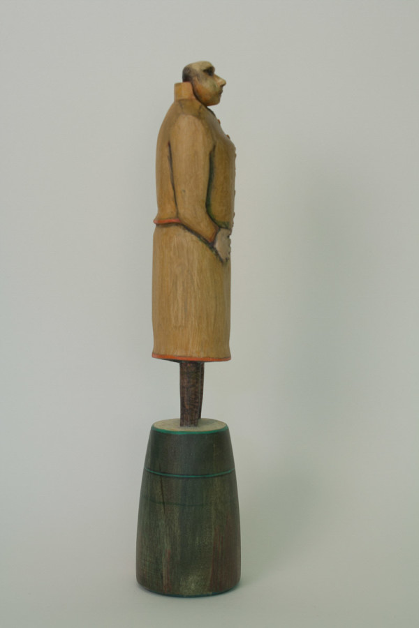 Woman in Ochre Suit (side view) by Eve Whitaker