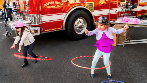 Hulu hoops by the fire truck by Alan Powell