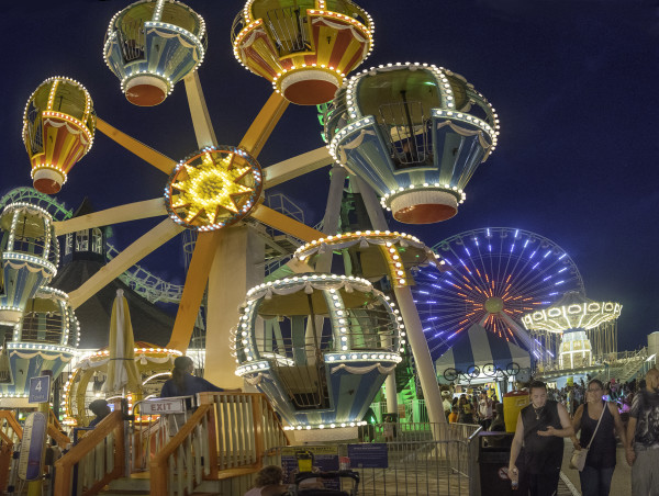 Amusement park rides at night by Alan Powell