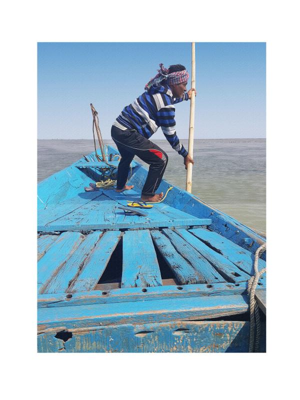 Boatman on Chillika Lake by Ellen Howell