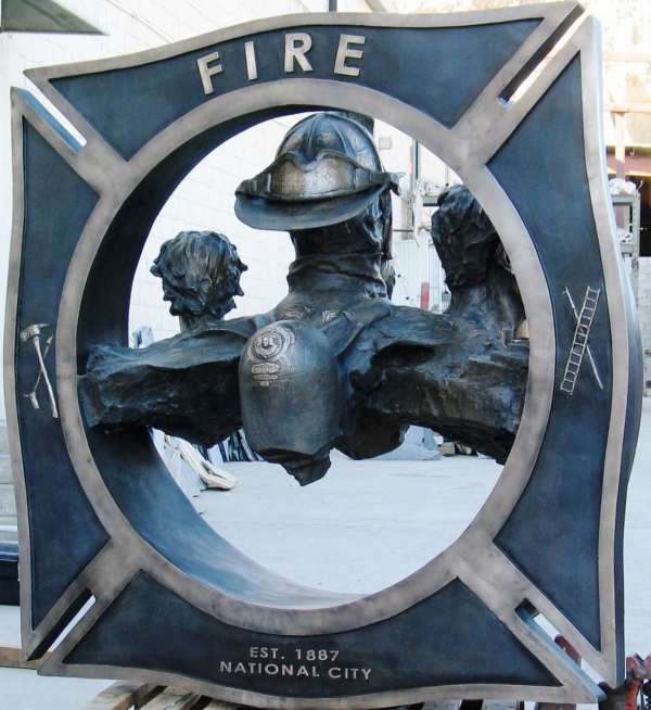 Relief work on NCFD sculpture by Richard Becker