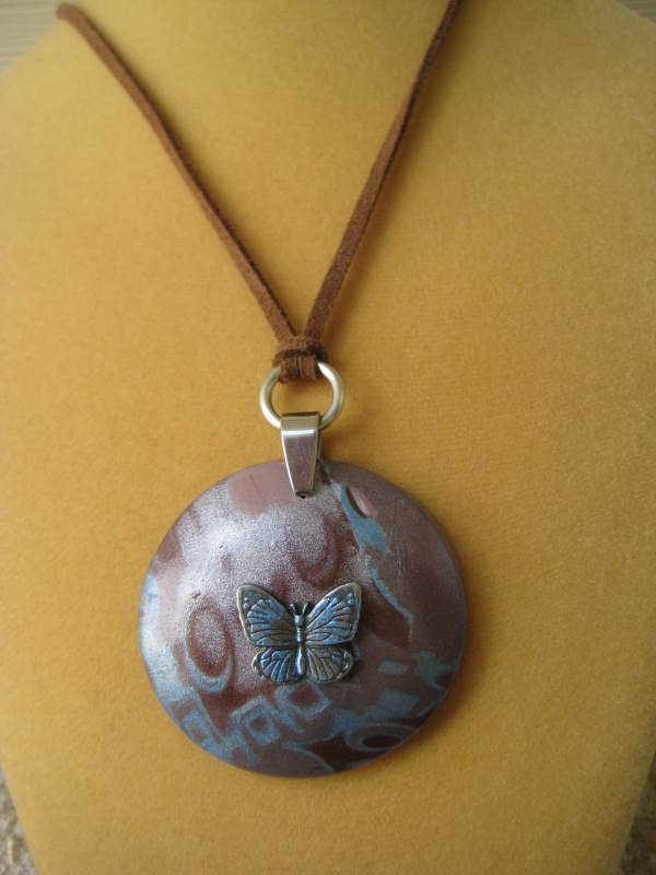 Blue/Brown Butterfly Necklace by Charmaine Harbort