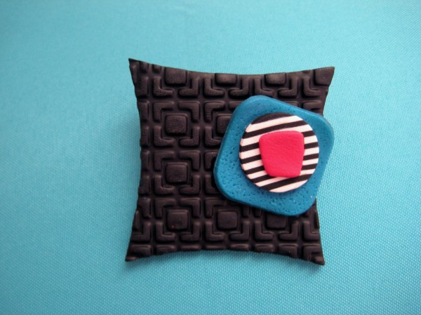 Red/Black/Blue Pin by Charmaine Harbort