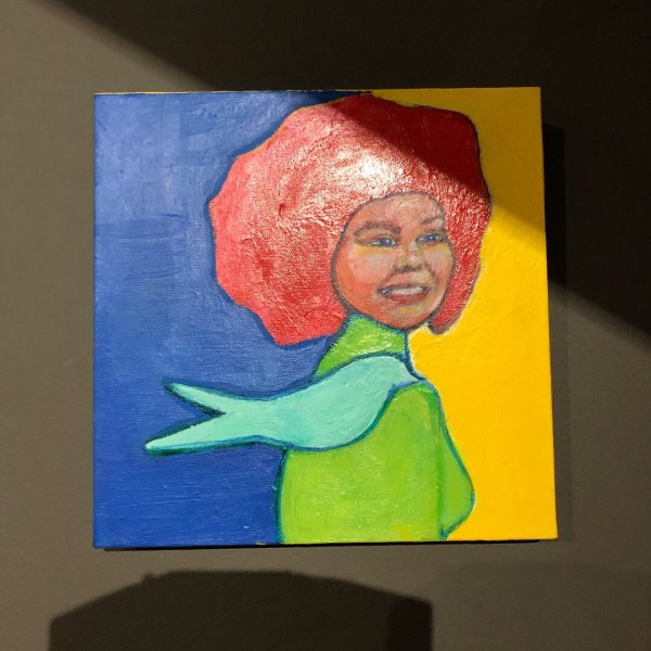 Woman with Green Bird by Judith Estrada Garcia