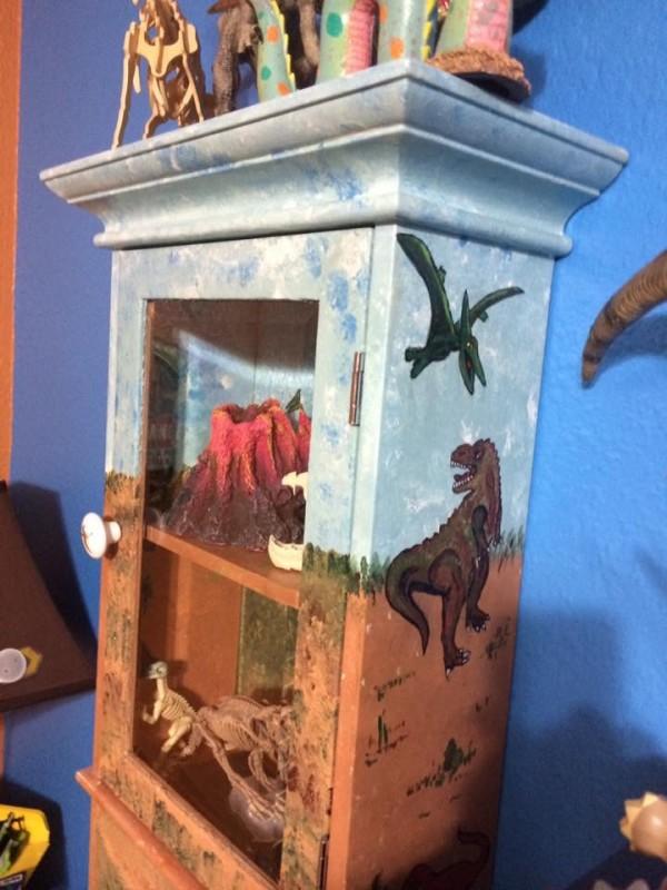 Dinosaur themed wall cabinet by Heather Medrano