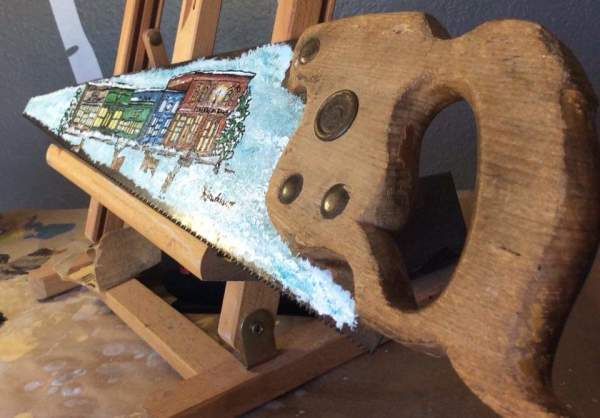 Colorado painted antique saw by Heather Medrano