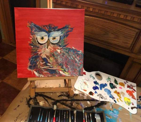 Bright owl w/ red canvas background by Heather Medrano