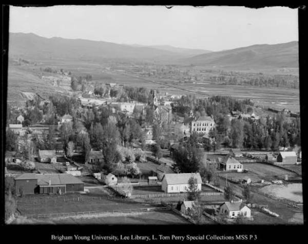 [Coalville as seen from Cemetery Hill, Beard's Opera House in left foreground (Marsh is now Echo Dam)] by George Beard