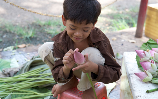 Boy with Flowers, Siem Reap, Cambodia    by Bart Marcy