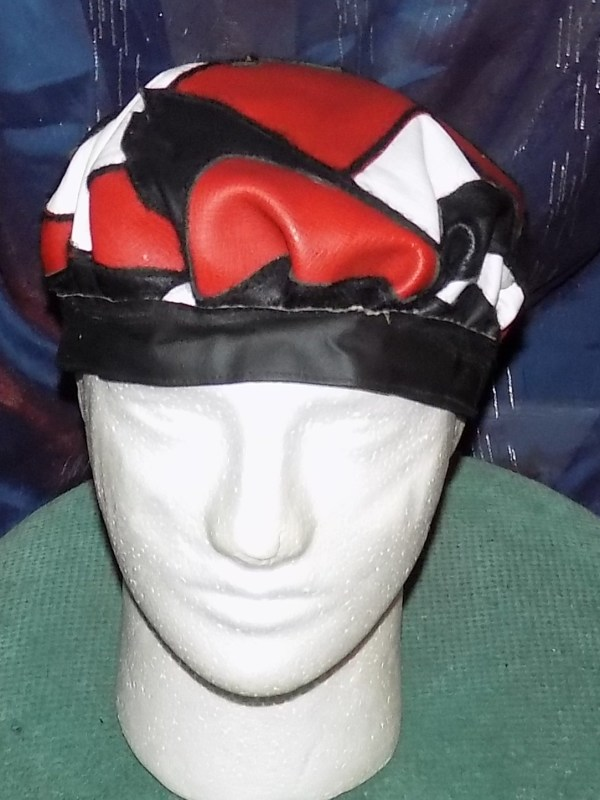 """Leather Cap -"""" just-pieces"""" in  red, white, and black leather by Annie Rich"""