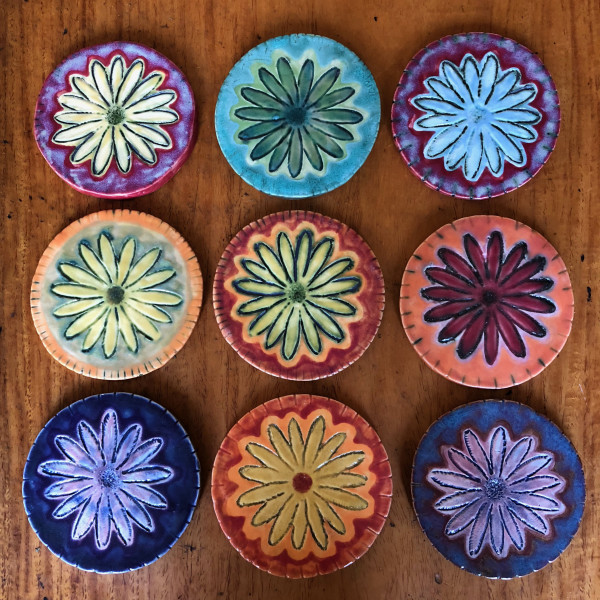 Daisy coasters, lots of colors by Nell Eakin