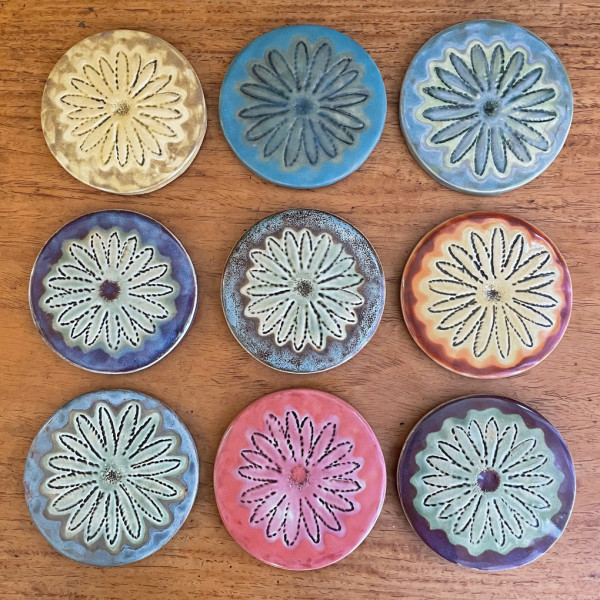 Daisy coasters,, order by number by Nell Eakin
