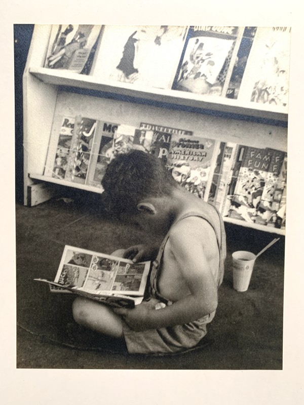 """Child Reading Comics"" by Margaret Daughtry"