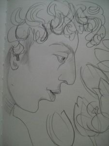 Boy in profile with tulips