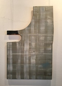 Wood shape with horizontal and vertical lines in gray green