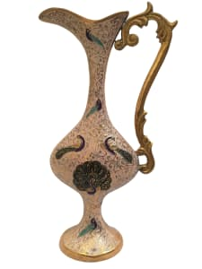 Classy and curvy vase with attractive detailing and a handle