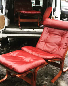 Pair of leather Wesnofa lounge chairs and ottomans