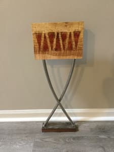Seven red triangles on a stand