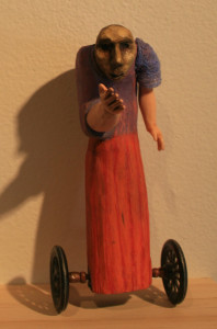 Stooped Doll on Metal Wheels