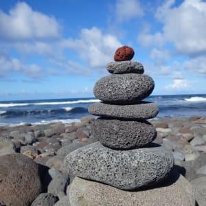 Black Sand Beach Stones by Vonzie Barnett