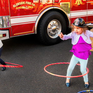 Hulu hoops by the fire truck by Alan Powell