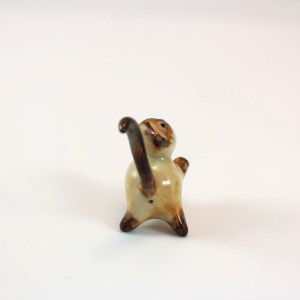 Miniature porcelain brown point siamese cat figurine