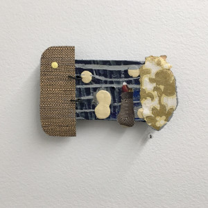 Small Assemblage with paint and wallpaper