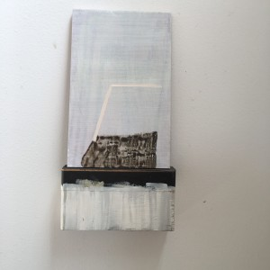 Small, leaning painting on painted  wooden block with tape by MaryAnn Puls