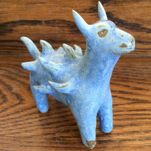 Spike the blue tufted dog by Nell Eakin