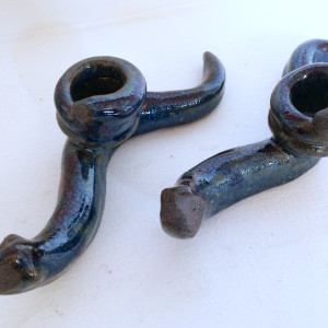 Dark blue slithering snake candle holders by Nell Eakin